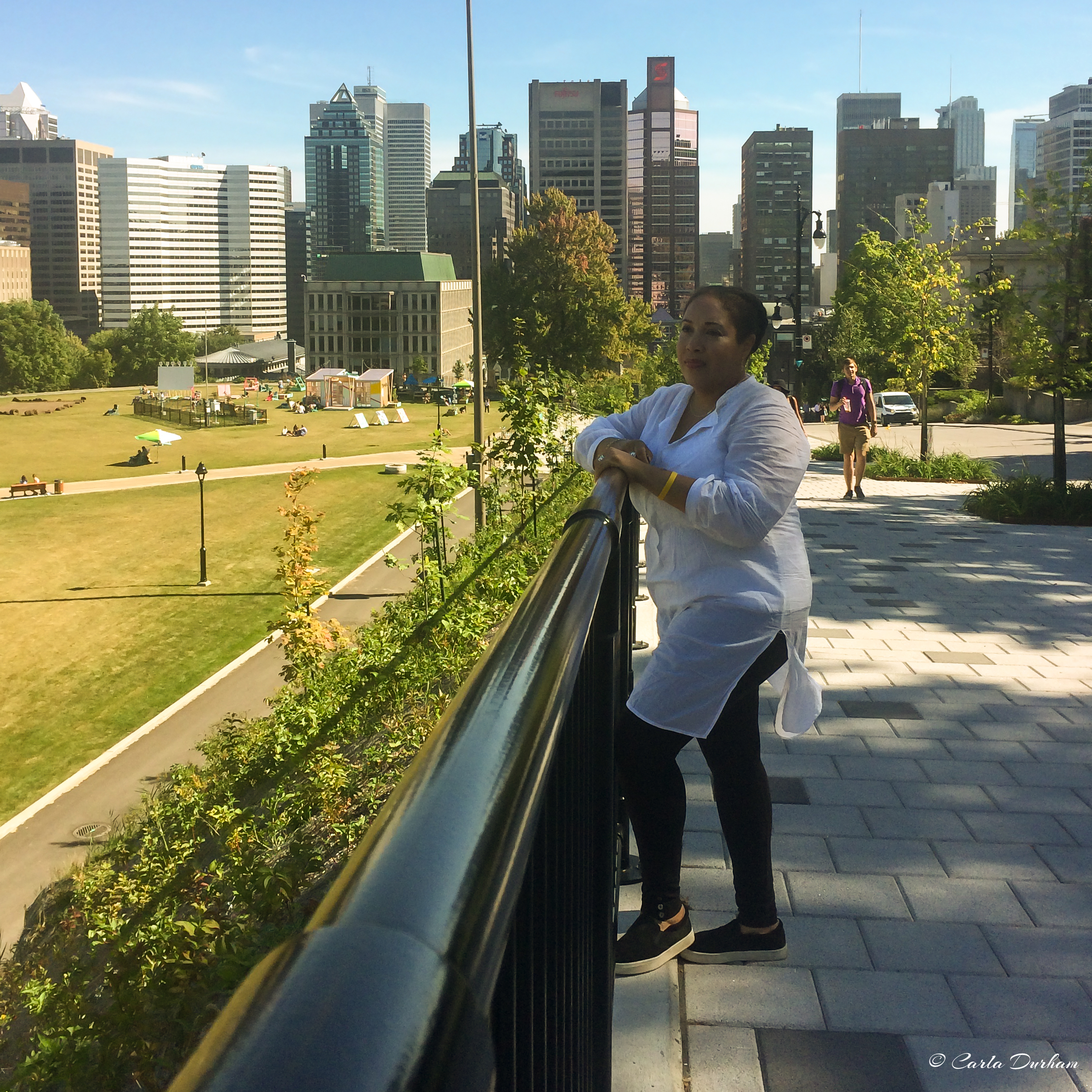 Carla Durham in Montreal, Canada with the skyline in the background